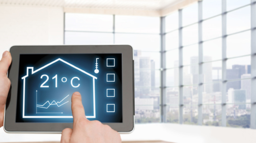 home, housing, people and technology concept - close up of man hands pointing finger to tablet pc computer and regulating room temperature over empty flat background